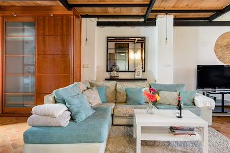 Drift off to Sleep Under Wooden Beams at a City Penthouse