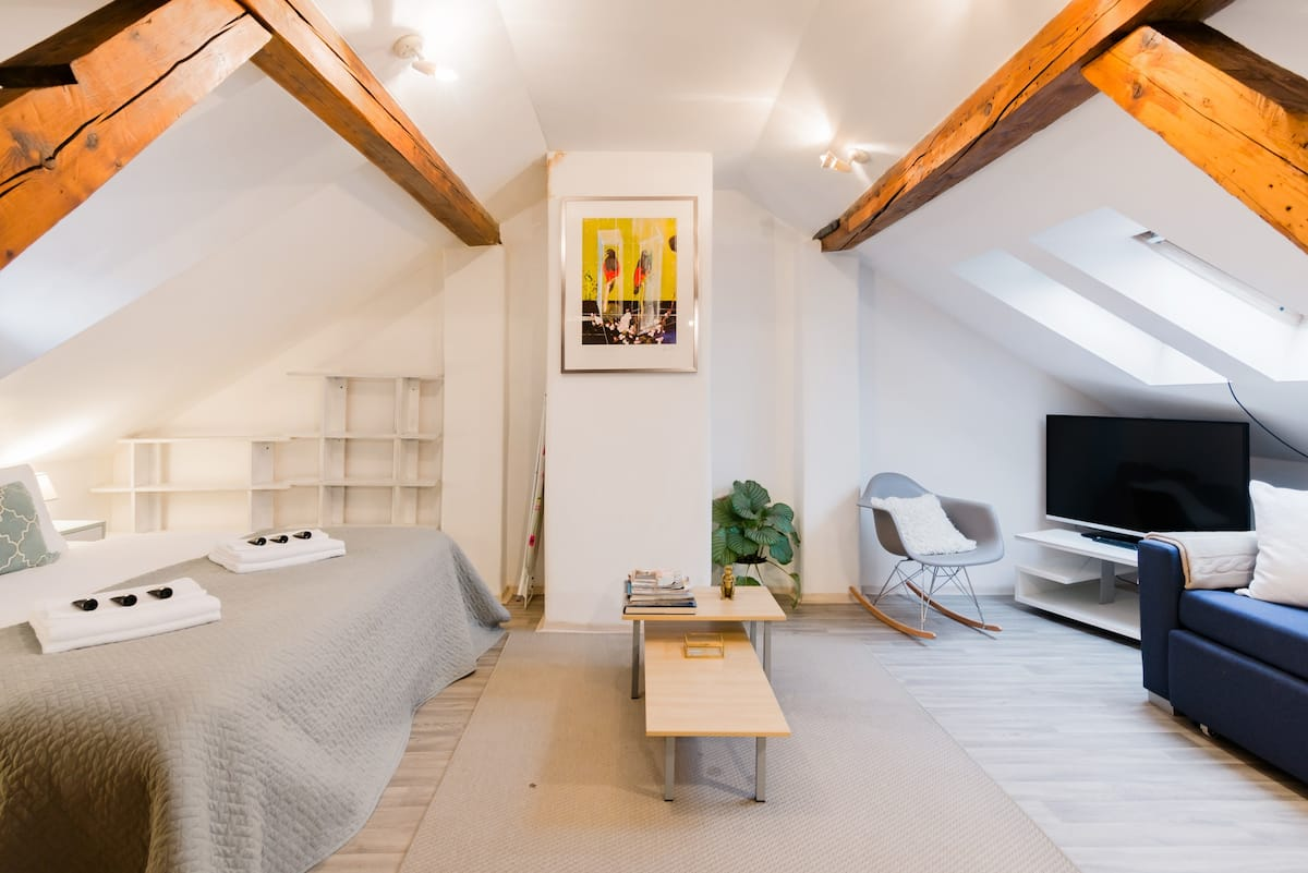 Overlook the Castle from a Cool, Cozy Attic Hideaway