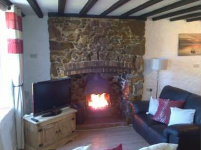Cottage by the sea with open fire