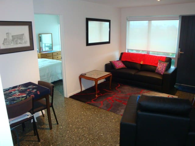 Modern studio with two bedrooms and living-area.