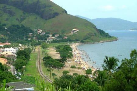 Triplex verde-Praia Grande
