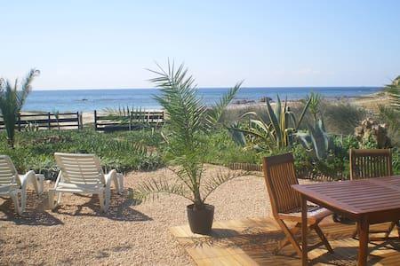 House sea edge Corsican beach(range