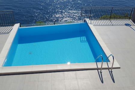 Amazing apartment on beach+huge terrace+pool