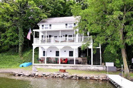 Inviting waterfront home with a dock, outdoor dining area & more! Dogs ok!