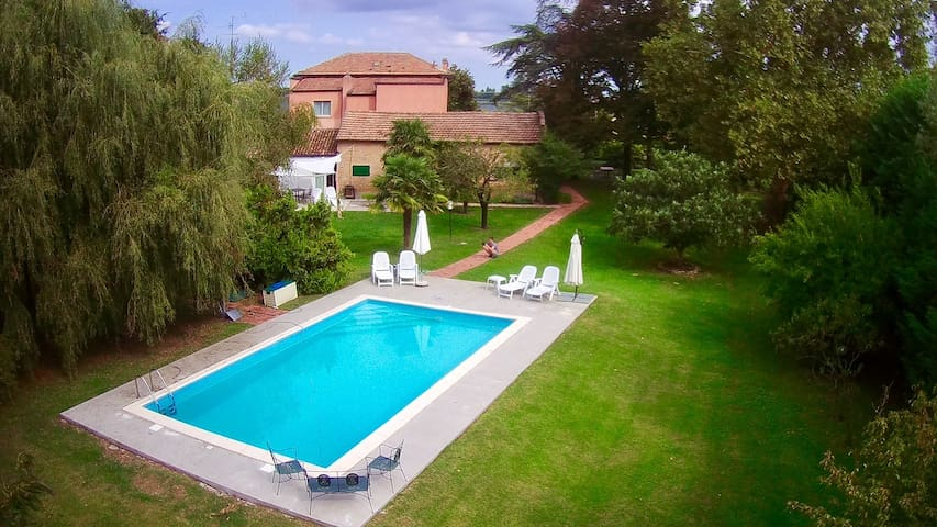 Secluded converted barn in large gardens with pool