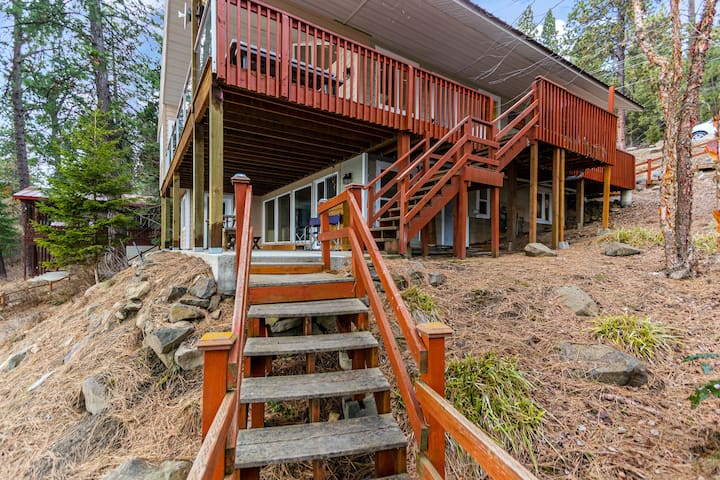 NEW LISTING! Oasis in the trees w/ wraparound deck, lake view & pool table!