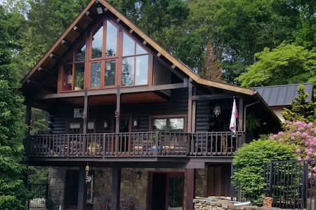 Harmony Lodge nestled in wooded tranquility.