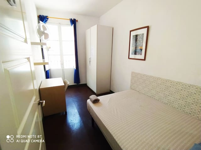 Large central room with double bed and  balcony.