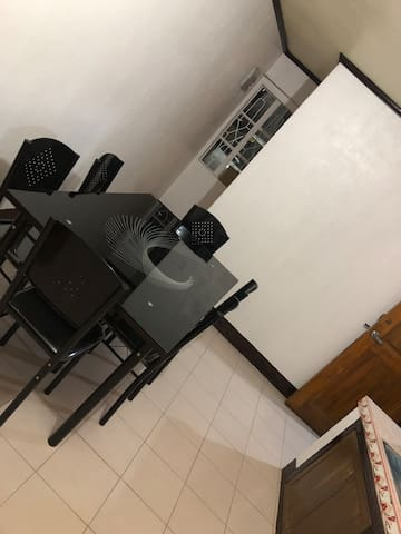 4 single beds with common kitchen and Living room