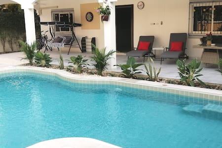 Villa swimming pool, pool table, dartboard, games