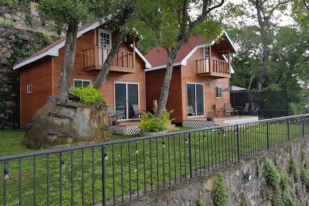 Preciosa cabaña a la orilla del lago. C