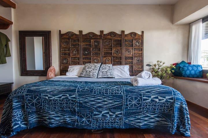 Straw bale house. Blue room