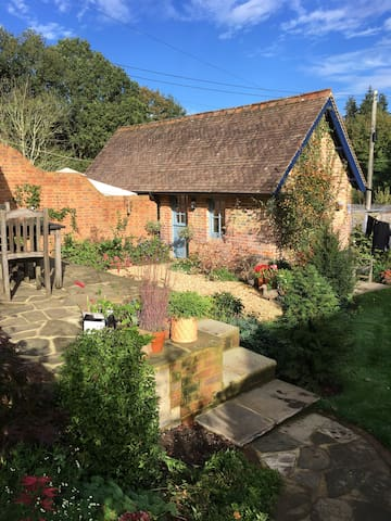 Attractive brick  outbuilding in courtyard setting