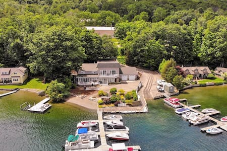 Stunning, large, fully loaded home with a hot tub, pool table and private dock!