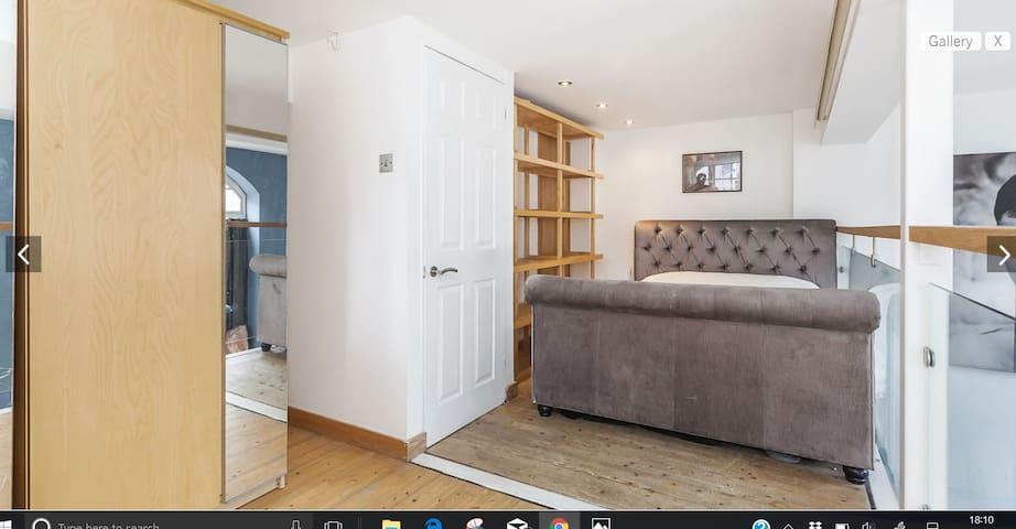 King size bed on  a loft open plan mezzanine