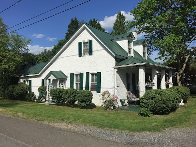 Rent Half of Colonial House with full kitchen.