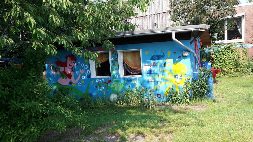 Secret garden with mermaid house