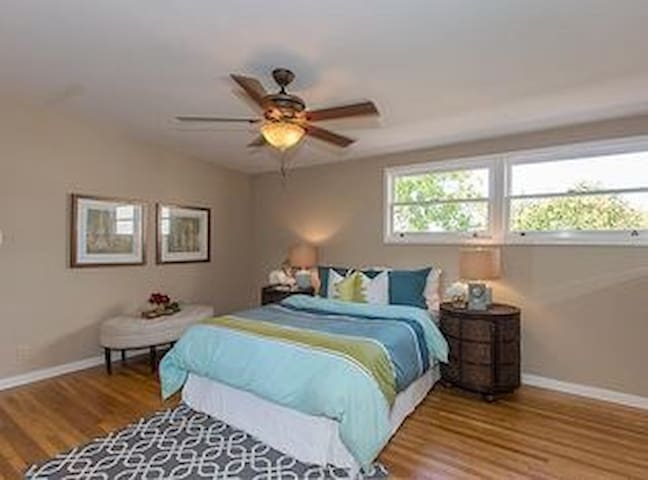 Big room with private bathroom and king sized bed.