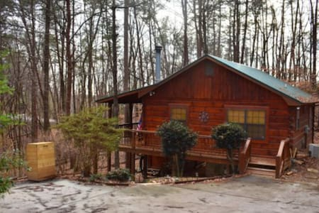 Dog-friendly cabin w/ a wood-burning fireplace, furnished deck, & gas grill