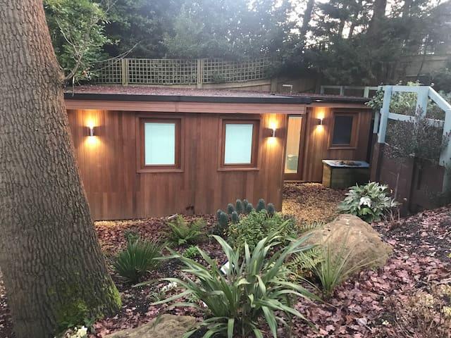 Romantic wood cabin set in mature gardens