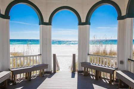 Mojo: Boardwalk to private beach. Sleeps 26.