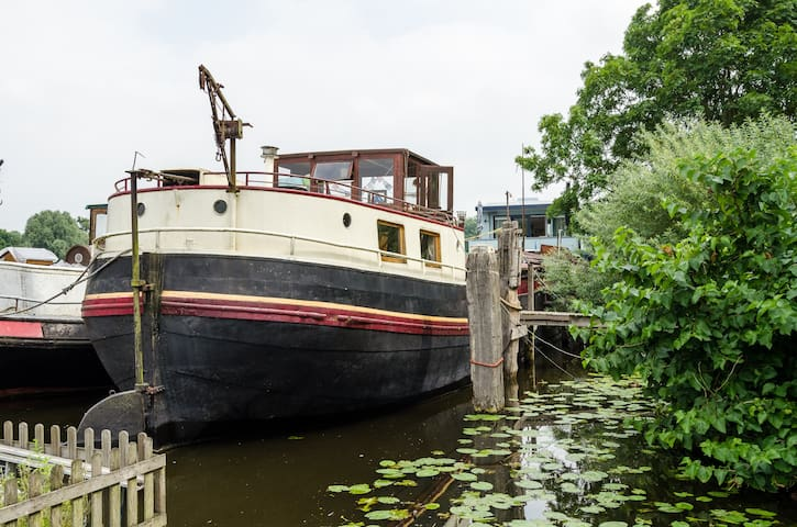 Authentic barge in the river Amstel in Amsterdam