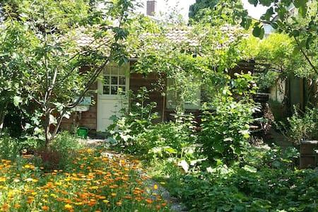 Private lodge in spacious city-garden near center