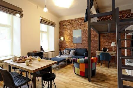 Old Riga loft style design studio, with extras