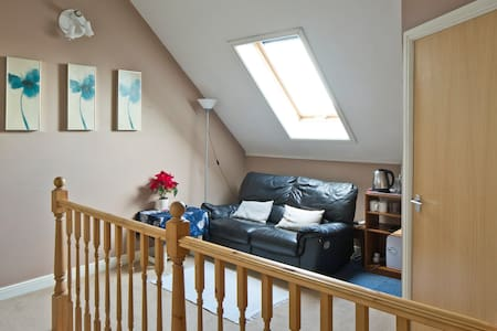 Self contained top floor with free parking