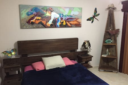 A Special Tropical Home - Downstairs Bedroom