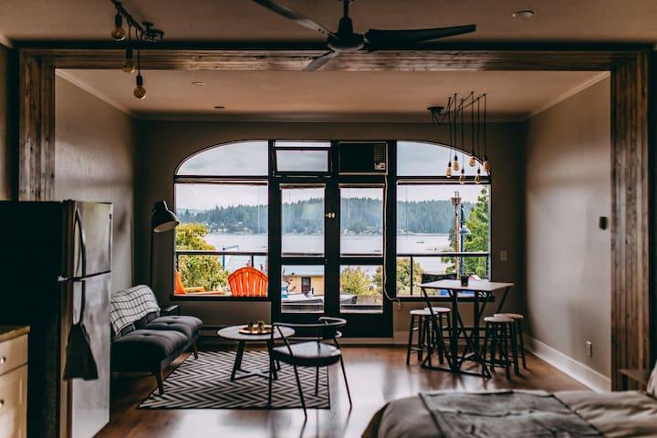 Industrial loft atop a cafe with big ocean views