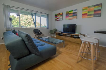 Downtown Condo with Mid-Century Flair!