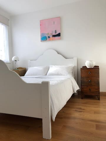 Bright clean bedroom & bathroom in charming house