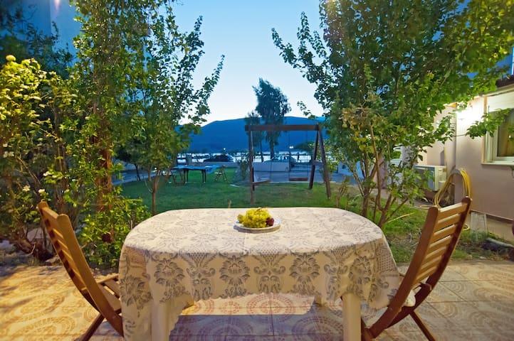 Front beach villa with big beautiful garden .