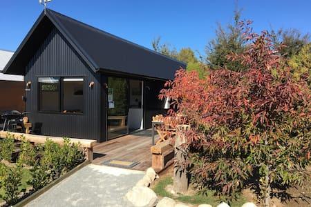 Black Beech House with  luxury cedar outdoor bath.