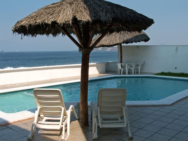 2 br condo just steps away from beach with pool