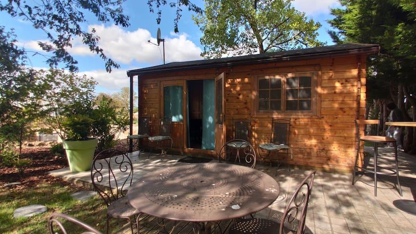 Comfortable wooden chalet in a beautiful garden