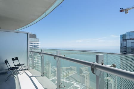 60th+ floor sub penthouse lake view condo