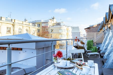 Attic with terrace in the heart SPb