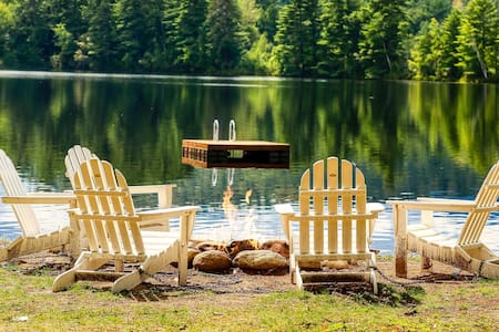 Lakefront home with private beach, and dock, close to skiing!