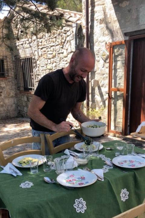 Francesco serves lunch